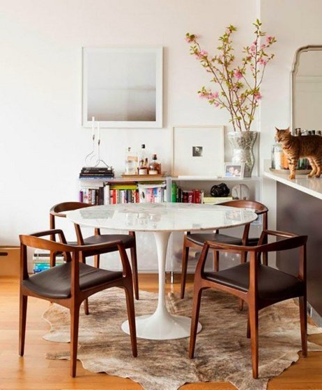 mid-century-modern-furniture-eero-saarinen-tulip-table-cowhide-rug